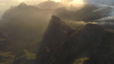 fuerteventura : Aerial view of mountains and fog creeping the cliffs on sunset in Tenerife, Canary islands, Spain