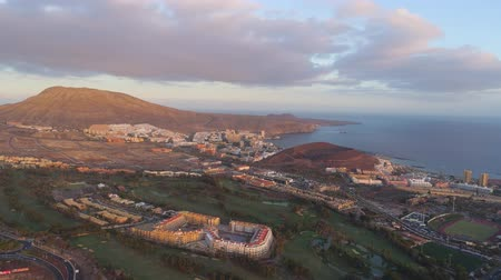Коста : Aerial view of Playa de las Americas on sunset in Tenerife, Canary Islands