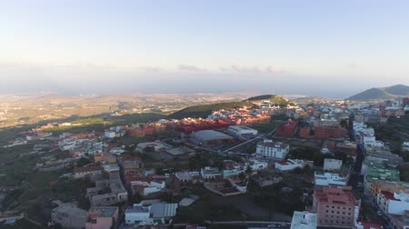 カナリア諸島 : Aerial view of a small town Granadillia on sunset among mountains in Tenerife, Canary Islands, Spain 動画素材