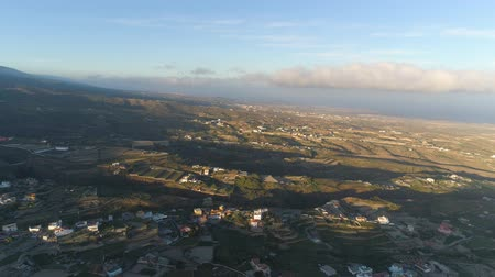kanarya : Aerial view of a small town Granadillia on sunset among mountains in Tenerife, Canary Islands, Spain Stok Video