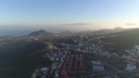 kanarya adaları : Aerial view of a small town Granadillia on sunset among mountains in Tenerife, Canary Islands, Spain Stok Video