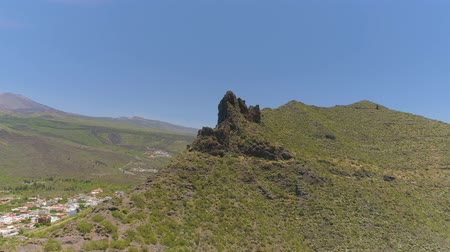 lookout point : Aerial view of rock and cliff mountains from above on Tenerife near volcanic mountain El Teide Stock Footage