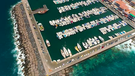 mooring : TENERIFE, LOS GIGANTES, SPAIN - MAY 18, 2018: Aerial view of modern sail boats, yachts in a seafront