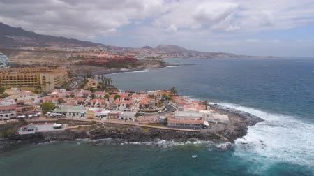 kanári : TENERIFE, LA CALETA, SPAIN - MAY 18, 2018: Aerial view rocky coast of Atlantic ocean, Canary islands