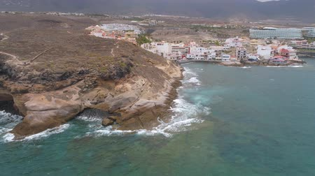 kanarya : TENERIFE, LA CALETA, SPAIN - MAY 18, 2018: Aerial view rocky coast of Atlantic ocean, Canary islands