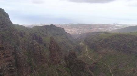 légi felvétel : TENERIFE, SPAIN - MAY 18, 2018: Aerial view of rocky mountains in Hell gorge, Canary islands