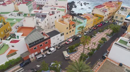 カナリア諸島 : TENERIFE, PUNTA BRAVA, SPAIN - MAY, 18, 2018: Aerial view Atlantic ocean coast and colorful houses .