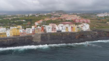 kanarya adaları : TENERIFE, PUNTA BRAVA, SPAIN - MAY, 18, 2018: Aerial view Atlantic ocean coast and colorful houses .