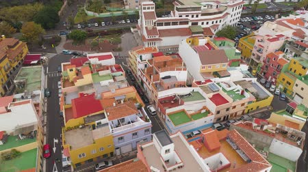 punta : TENERIFE, PUNTA BRAVA, SPAIN - MAY, 18, 2018: Aerial view colorful houses of small town on the coast Stock Footage