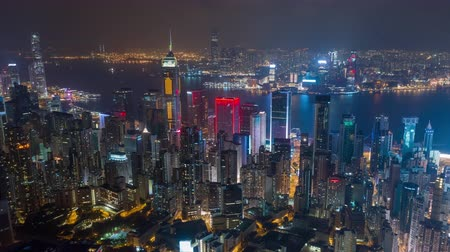 gelişme : HONG KONG - MAY 2018: Aerial timelapse view of Causeway Bay and Wan Chai disrtict, city from above at night.