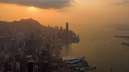 hong kong : HONG KONG - MAY 2018: Aerial view of Central district and Victoria Bay. Sunset over Victoria peak with clouds.