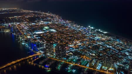 drone miami : MIAMI, FLORIDA, USA - JANUARY 2019: Aerial drone panorama view flight over Miami beach at night. Aero dronelapse in 4K. Stock Footage