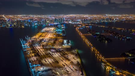 drone miami : MIAMI, FLORIDA, USA - JANUARY 2019: Aerial drone panorama view flight over Miami at night. Aero dronelapse in 4K.