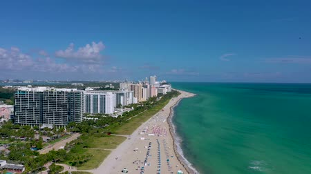 drone miami : MIAMI, FLORIDA, USA - JANUARY 2019: Aerial drone panorama view flight over South Miami beach ocean coastline.