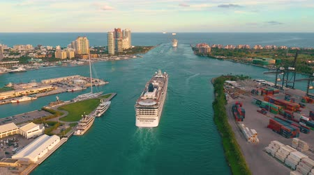 drone miami : MIAMI, FLORIDA, USA - JANUARY 2019: Aerial drone view flight over Miami sea port. Ships and cruise liners at the pier.