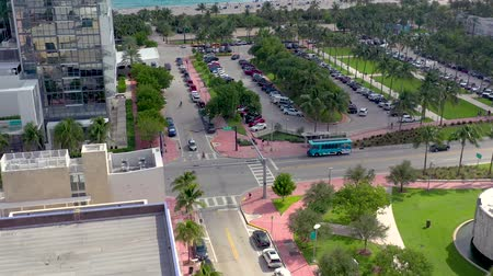 Майами : MIAMI, FLORIDA, USA - MAY 2019: Aerial drone panorama view flight over Miami beach city centre. Collins park from above.