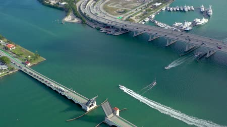 высотное : MIAMI, FLORIDA, USA - MAY 2019: Aerial drone view flight over Miami Biscayne Bay. Overpasses and viaducts from above.
