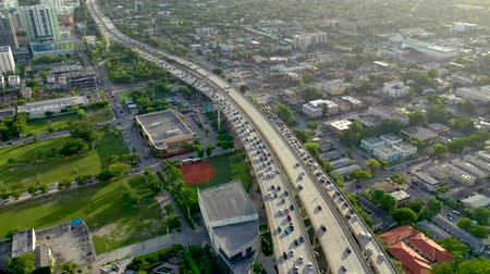 высотное : MIAMI, FLORIDA, USA - MAY 2019: Aerial drone view flight over Miami downtown. Road viaduct and overpass from above.