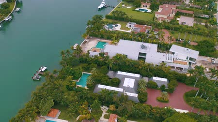 billionaire : MIAMI, FLORIDA, USA - MAY 2019: Aerial drone view flight over Miami Biscayne Bay and Indian Creek island. Luxury houses.