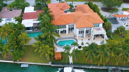 milliomos : MIAMI, FLORIDA, USA - MAY 2019: Aerial drone view flight over Miami Biscayne Bay and Indian Creek island. Luxury houses.