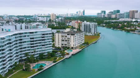 esplendor : MIAMI, FLORIDA, USA - MAY 2019: Aerial drone view flight over Miami Biscayne Bay and Indian Creek island. Luxury houses.