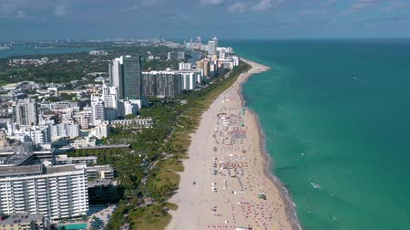 drone miami : MIAMI, FLORIDA, USA - MAY 2019: Aerial drone panorama view flight over Miami beach. South Beach sand and sea from above.