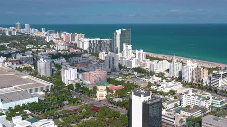 merkez : MIAMI, FLORIDA, USA - JANUARY 2019: Aerial drone panorama view flight over Miami beach city centre.
