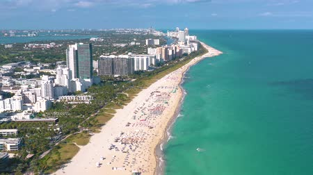 sombrillas : MIAMI, FLORIDA, USA - MAY 2019: Aerial drone panorama view flight over Miami beach. South Beach sand and sea from above.