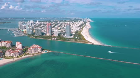 parasol : MIAMI, FLORIDA, USA - MAY 2019: Aerial drone view flight over Miami beach. South Beach and Fisher island from above.