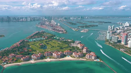 milliomos : MIAMI, FLORIDA, USA - MAY 2019: Aerial drone view flight over Miami beach. South Beach and Fisher island from above.