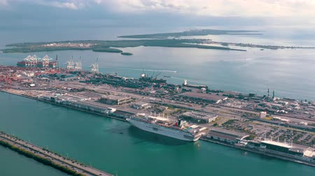 ライナー : MIAMI, FLORIDA, USA - JANUARY 2019: Aerial drone view flight over Miami sea port. Ships and cruise liners at the pier.