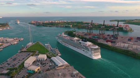 altitude : MIAMI, FLORIDA, USA - JANUARY 2019: Aerial drone view flight over Miami sea port. Ships and cruise liners at the pier.