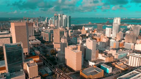 bestrating : MIAMI, FLORIDA, USA - MAY 2019: Aerial drone view flight over Miami downtown. Hotels, business buildings from above.