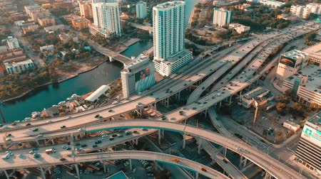 drone miami : MIAMI, FLORIDA, USA - MAY 2019: Aerial drone view flight over Miami downtown. Road viaduct and overpass from above.