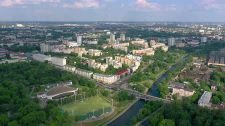 lehet : MINSK, BELARUS - JUNE, 2019: Aerial drone shot view of city centre. Streets from above at sunny day.