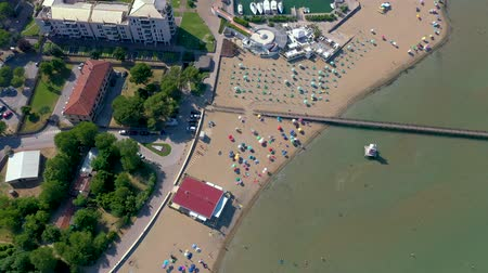 parasol : LIGNANO, ITALY - MAY, 2019: Lignano beach at Adriatic sea coastline in Italy aerial drone view. Europe during summer.