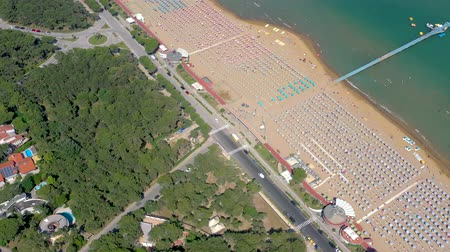 farol : LIGNANO, ITALY - MAY, 2019: Lignano beach at Adriatic sea coastline in Italy aerial drone view. Europe during summer.
