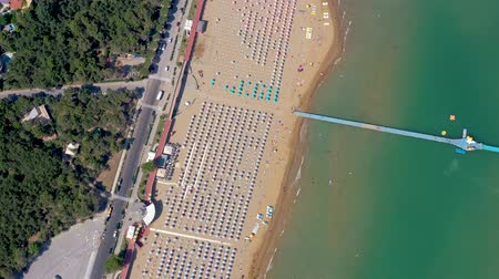 parasol plage : Lignano beach at Adriatic sea coastline in Italy aerial drone view. Europe during summer. Vidéos Libres De Droits