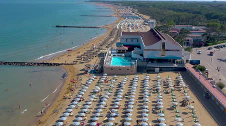 адриатический : LIGNANO, ITALY - MAY, 2019: Lignano beach at Adriatic sea coastline in Italy aerial drone view. Europe during summer.