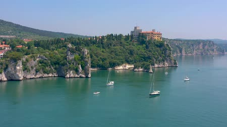 век : Sea shore near Trieste, Italy. Aerial drone view of ruines of the old fortress of Duino Castle.