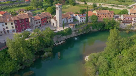 укрепленный : UDINE PROVINCE, ITALY - JUNE, 2019: Aerial panorama drone view of small town Cividale del Friuli beautiful architecture Стоковые видеозаписи