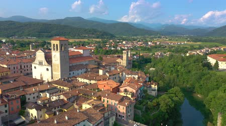 восстановлено : UDINE PROVINCE, ITALY - JUNE, 2019: Aerial panorama drone view of small town Cividale del Friuli beautiful architecture Стоковые видеозаписи
