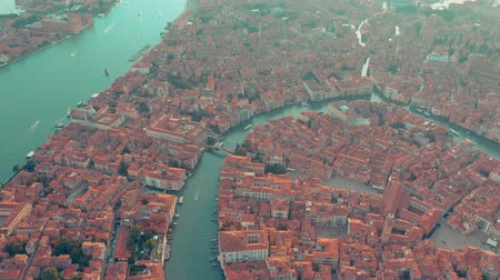 venedik : VENICE, ITALY - JUNE, 2019: Aerial drone panorama view of Venice beautiful architecture. Flight over canals and roofs. Stok Video