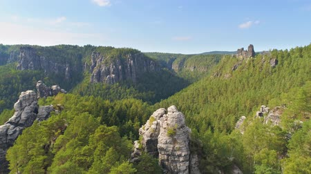 восход : Bastei Park in Saxony, Germany, wonderful aerial drone panorama view. Стоковые видеозаписи