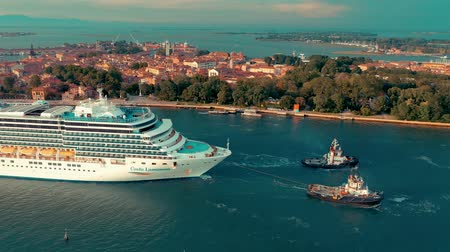 venedik : VENICE, ITALY - JUNE, 2019: Aerial drone panorama view of Venice. Сruise ship sails past historic sites.
