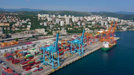 балканский : RIJEKA, CROATIA - MAY, 2019: Aerial view drone shot of Rijeka city port on Adriatic Sea shore.