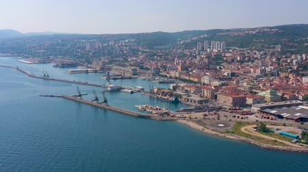 балканский : RIJEKA, CROATIA - MAY, 2019: Aerial view drone shot of Rijeka city on Adriatic Sea shore. City from above.
