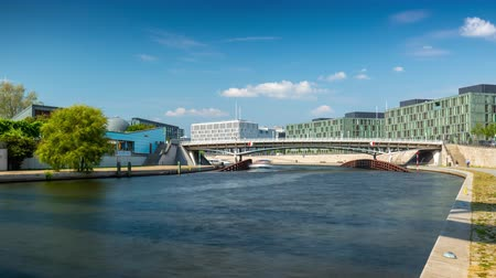 pitka : BERLIN, GERMANY - MAY,2019: Timelapse view of a bridge over Spree River, with boats in the city centre near Bundestag.