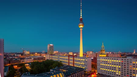 körképszerű : BERLIN, GERMANY - MAY,2019: Timelapse view of Central Berlin and famous television tower near Spree River