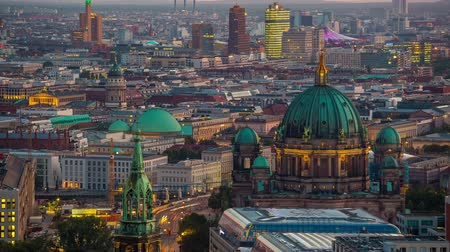 berlin skyline : BERLIN, GERMANY - MAY,2019: Timelapse view of Berlin city centre from above, famous historical buildings at sunset.